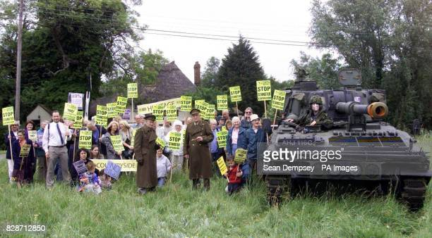 Protester Ed Jones wearing a Tony Blair mask sits on a tank outside the medieval Three Horseshoes pub at Mole Hill Green Essex near Stansted Airport...