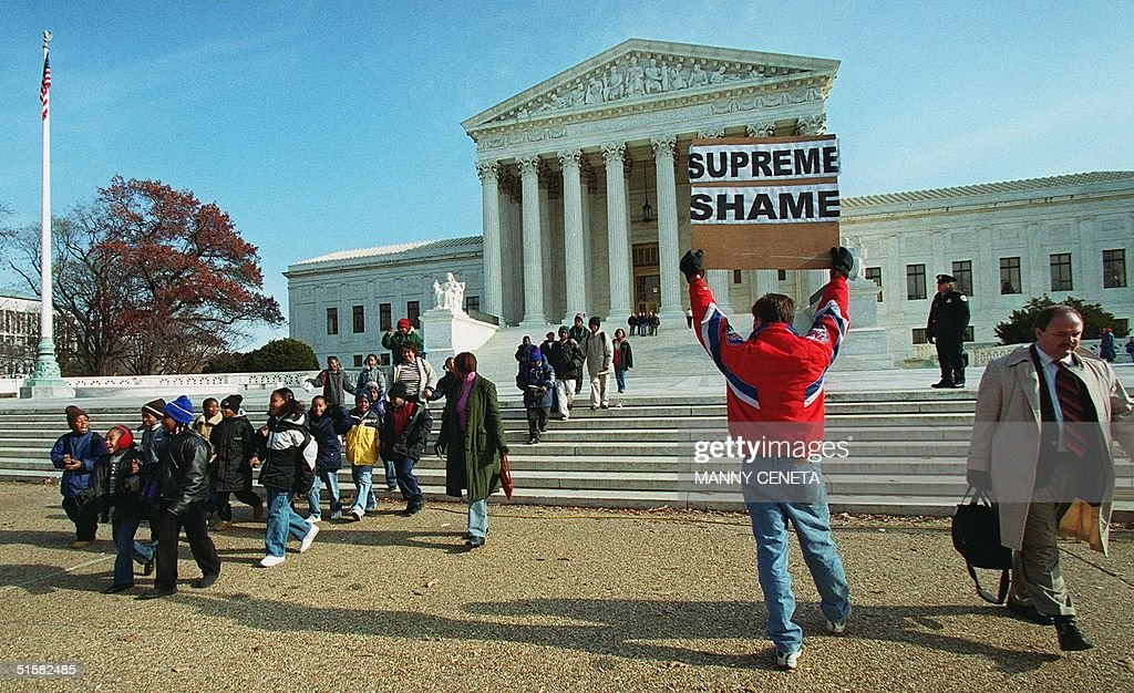 A protester expresses his opinion of the US Suprem : News Photo