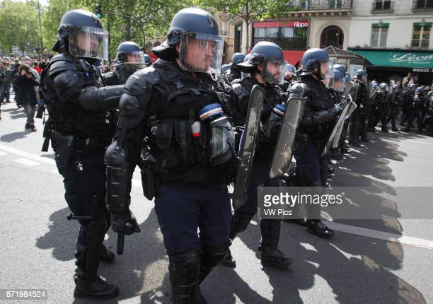 Protester face French antiriot police during a march for the annual May Day workers' rally in Paris on May 1 2017