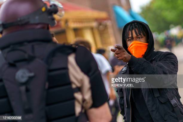A protester faces off with Minnesota State Police officers on May 29 2020 in Minneapolis Minnesota Minneapolis police officer Derek Chauvin who was...
