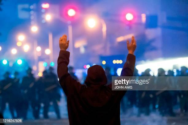 TOPSHOT A protester faces off with police during rioting and protests in Atlanta on May 29 2020 The death of George Floyd on May 25 while under...