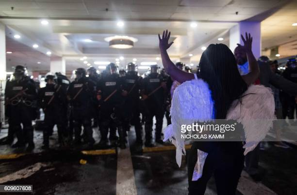 TOPSHOT A protester faces riot police during a demonstration against police brutality in Charlotte North Carolina on September 21 following the...