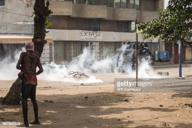 Protester faces security forces during clashes as part of an anti-government protest in Lome on October 18, 2017. Protesters erected makeshift...