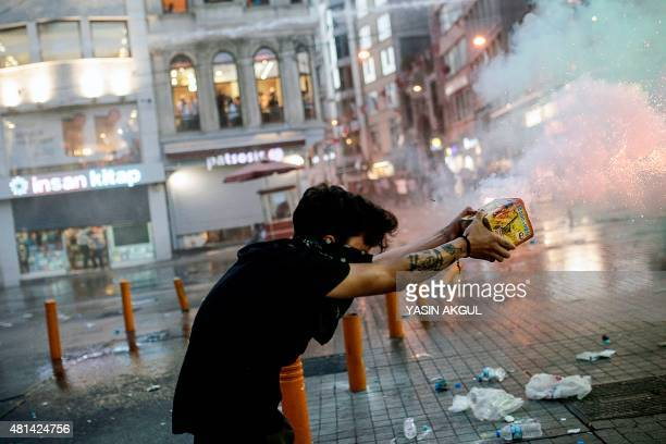 Protester fires fireworks at Turkish riot police during a demonstration on July 20, 2015 in Istiklal avenue in Istanbul, after a suicide bombing in...