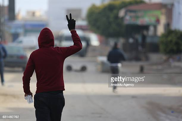 A protester flashes victory sign as the protesters demanding social rights to citizens and resolution of the crisis at Ras Jadir border crossing...