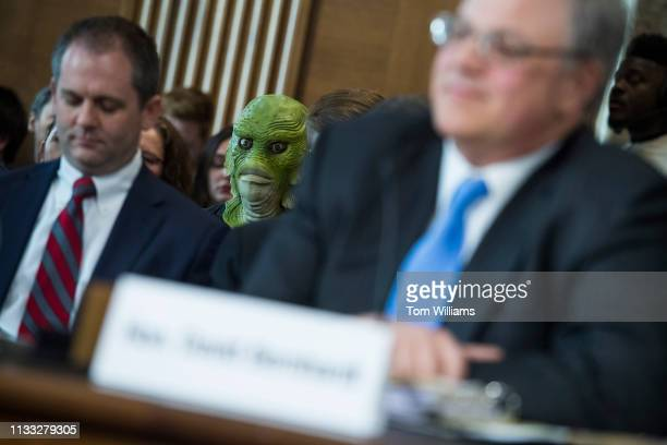 A protester from Clean Water Action is seen during the during the Senate Energy and Natural Resources Committee confirmation hearing for David...