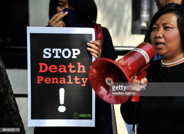 A protester from Migrant Care delivers a speech to protest against Saudi government regarding the execution of an Indonesian migrant worker Zaini...