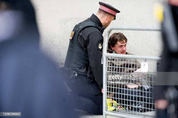 Protester from the Green Anti-Capitalist Front held under arrest during clashes with Police after the group entered the London Stock Exchange armed...