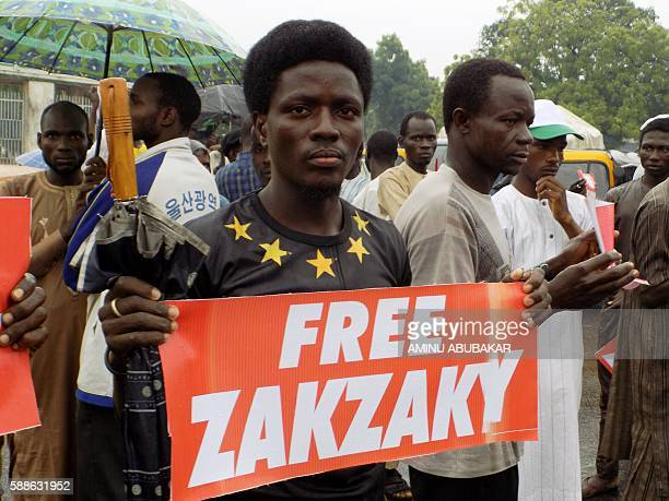A protester from the proIranian Islamic Movement in Nigeria carries a banner during a march in the streets to press for the release of their leader...