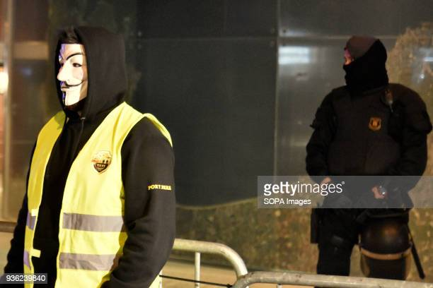 A protester from the Trade Union of taxi drivers Elite with a mask of anonymity against the delegation of transport of the Government of Catalonia...