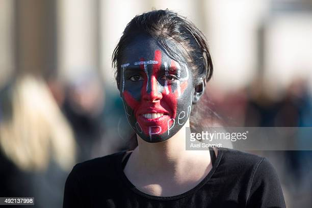 Protester gathers to demonstrate against the TTIP and CETA trade accords on October 10 2015 in Berlin Germany Tens of thousands took to the streets...