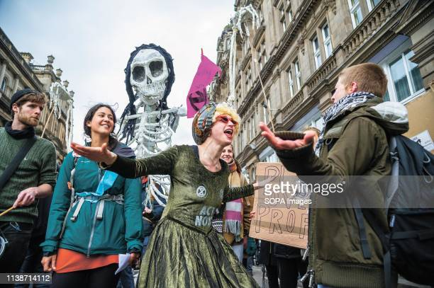 A protester gesticulating to each other during the Extinction Rebellion protest Extinction Rebellion held a lockdown of Edinburgh's North Bridge as...