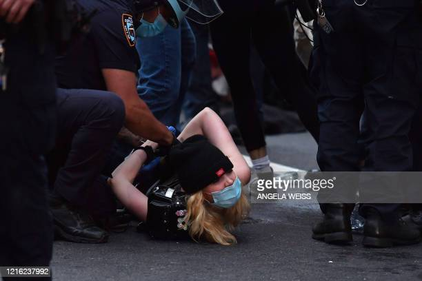 A protester gets arrested during a Black Lives Matter protest near Barclays Center on May 29 2020 in the Brooklyn borough of New York City in outrage...
