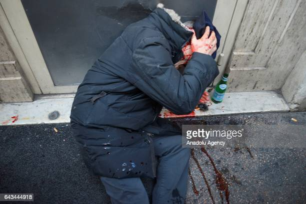 Protester gets injured during taxi drivers' strike to protest the amendment on app-based car transport company Uber in Rome, Italy on February 21,...