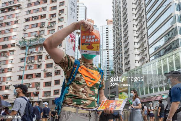 Protester giving out leaflets asking for joint signatures from Hong Kong citizens to express their view against the national security law. Thousands...