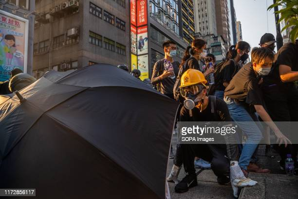 Protester guards his position in the front line while other protesters try to retreat as the police were closing in to make arrests. Entering the...