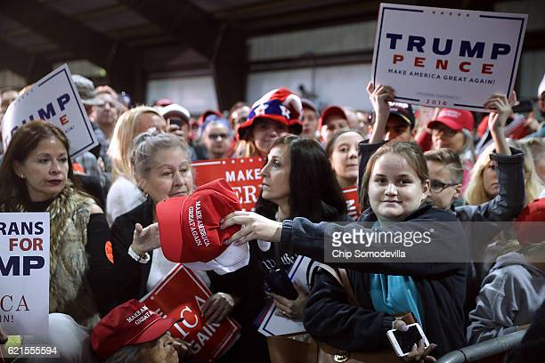 A protester hands Make America Great Again ballhats while shouting Do you respect women Donald as Republican presidential nominee Donald Trump...