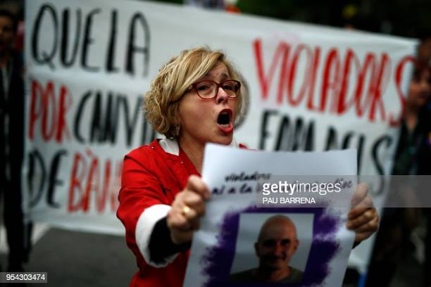 """Protester hold a banner with a picture of convicted of rape Gregorio Cano Beltri dubbed """"The Rapist of la Verneda"""" during a demonstration against his..."""