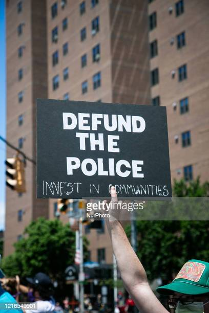 Protester hold a sign during a gathering to protest the recent death of George Floyd on May 30 2020 in New York US In response to the policerelated...