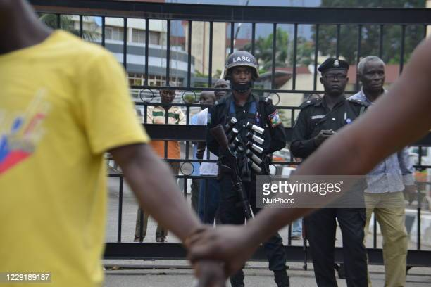 Protester hold hands to barricade the protesters from the men of the Nigerian Police force as protesters march at Alausa Secretariat in Ikeja, Lagos...