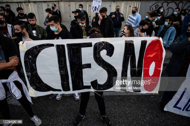 Protester holding a banner during a demonstration in the Foreigners Detention Center in Aluche, supporting 41 inmates that are on a hunger strike...