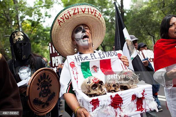 A protester holding a coffin with three skulls symbolising the death of Justice Democracy and Freedom with text on the top saying 'It was the State'...