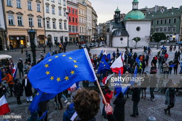 Protester holding a European Union flag during the demonstration. People protest against the ruling Law and Justice party right wing government which...