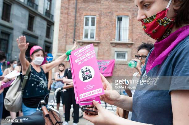 Protester holding a Non Una di Meno's brochure on gender violence during the demonstration. The feminist movement, Not One Less called for a...