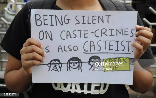 Protester holding a placard during the demonstration. Protesters gathered during a protest against caste based sexual violence happening in different...