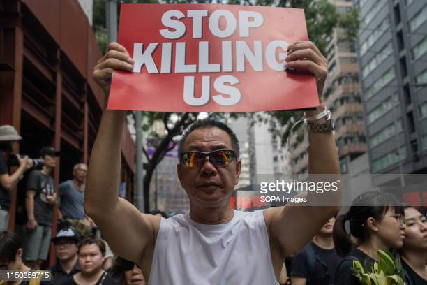 A protester holding a placard reads Stop killing us during the demonstration Despite the Chief Executive Carrie Lam's attempt to ease the heightened...
