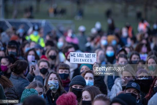 Protester holding a placard saying, we will not be silenced, during the vigil for Sarah Everard being held at Clapham Common. 33 year old Sarah...