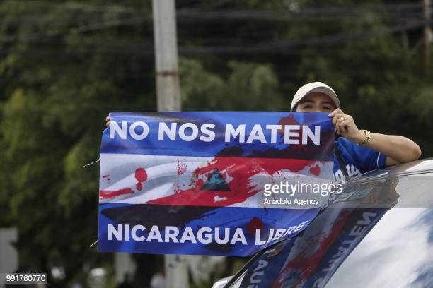 A protester holding a poster attends a protest against Nicaraguan President Daniel Ortega's government in Managua Nicaragua on July 04 2018 Thousands...