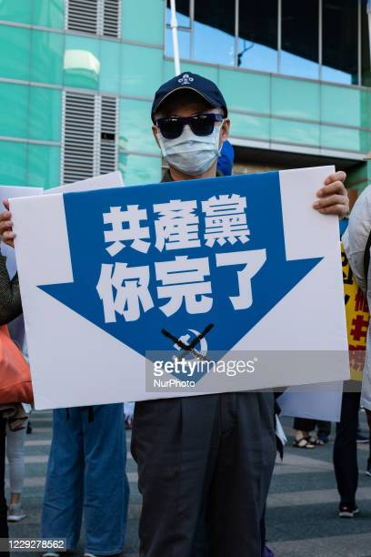Protester holding a sign calling for the end of the Chinese Communist Party on October 25, 2020 in Taipei, Taiwan. On Saturday Taiwan, Tibetans,...