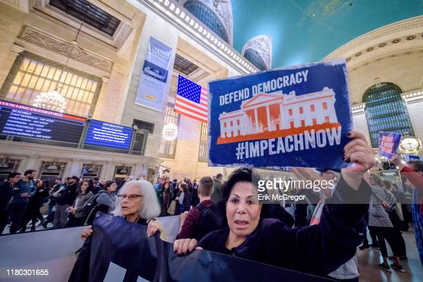 Protester holding a sign reading IMPEACH NOW In the heels of the corrected testimony of US Ambassador to the EU Gordon Sondland admitting he...