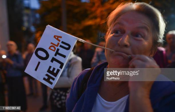 A protester holds '0 For Hate' inscription on a small flag Members of the Committee for the Defence of Democracy and members of the Polish opposition...
