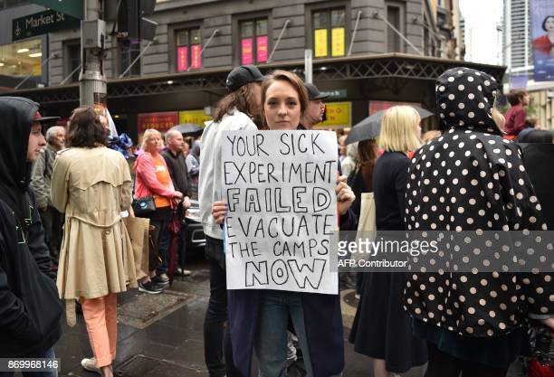 A protester holds a banner a rally in Sydney to urge the Australian government to end the refugee crisis on Manus Island on November 4 2017 The...