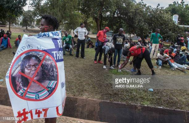 Protester holds a banner against the Malawi Electoral Commission chairperson Jane Ansah during a demonstration by Malawi opposition supporters...