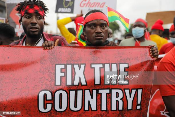 Protester holds a banner during #fixthecountry protest in Accra, Ghana, on August 4, 2021. The protest aims to demand accountability, good...