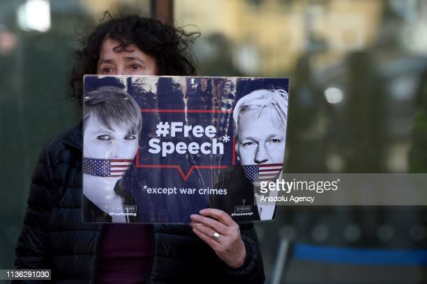 A protester holds a banner reading Free Speech Except War Crimes during a protest outside Westminster Magistrates court in London United Kingdom on...
