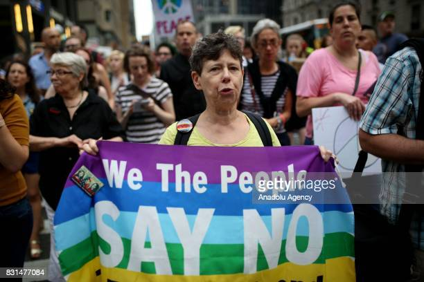 A protester holds a banner reading We The People Say No during a rally against US President Donald J Trump for threating North Korea and Venezuela...