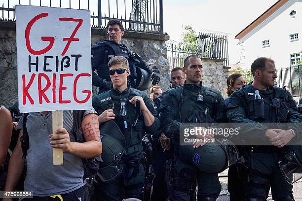 A protester holds a banner with written slogan 'G7 heisst Krieg ' during an anti G7 demonstration in front of the Marshall Center on June 5 2015 in...
