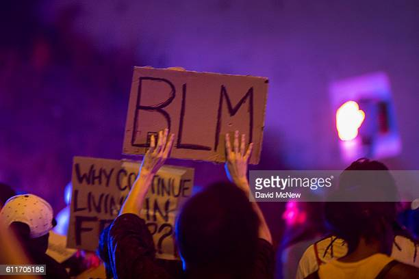 A protester holds a Black Lives Matter placard during march in reaction to the fatal police shooting of unarmed black man Alfred Olango on September...