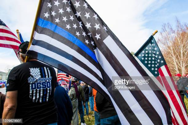 Protester holds a blue lives matter flag during the rally Pro Trump supporters take part in the 'Million MAGA March' at the state capital building....