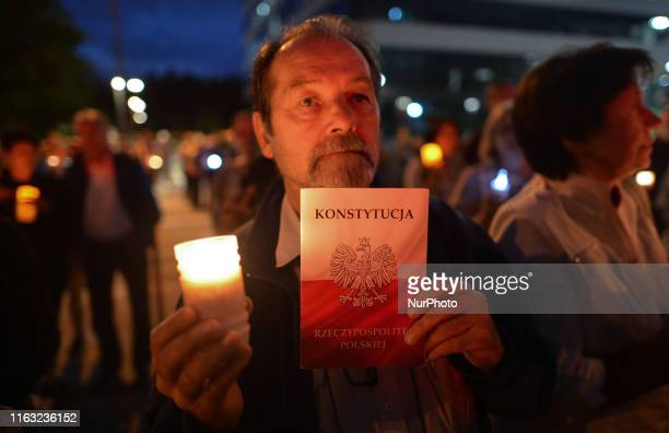 A protester holds a copy of the Polish Constitution Members of the Committee for the Defence of Democracy and members of the Polish opposition...