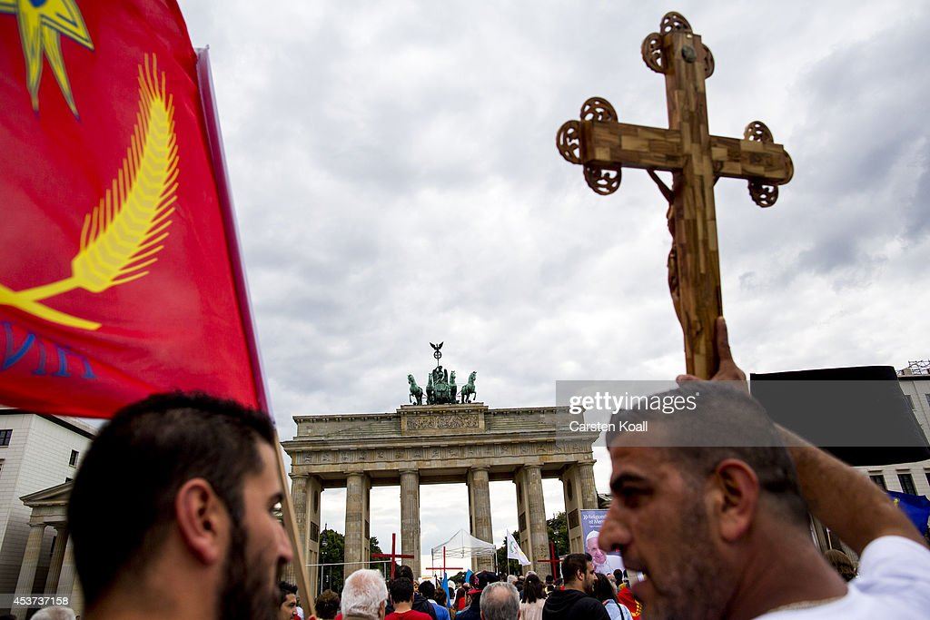 A protester holds a crucifix as more then thousand participants of several oriental christian groups gather to protest against the ongoing violence against their brethren in Iraq and Syria by ISIS fighters on August 17, 2014 in Berlin, Germany. Tens of thousands of Yazidis, who practice their own religion and are neither Christian nor Muslim have fled targeted violence from ISIS Muslim Sunni fighters in the region of northern Iraq that borders Syria and Kurdish regions. ISIS has targeted Christians and Shia Muslims as well.