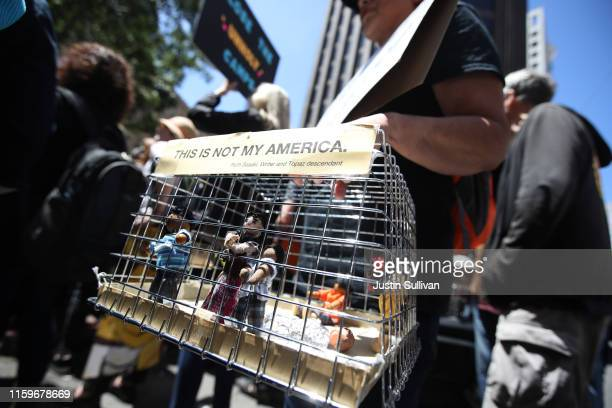 A protester holds a diorama of kids locked in a cage during a demonstration against migrant detention facilities on July 2 2019 in San Francisco...