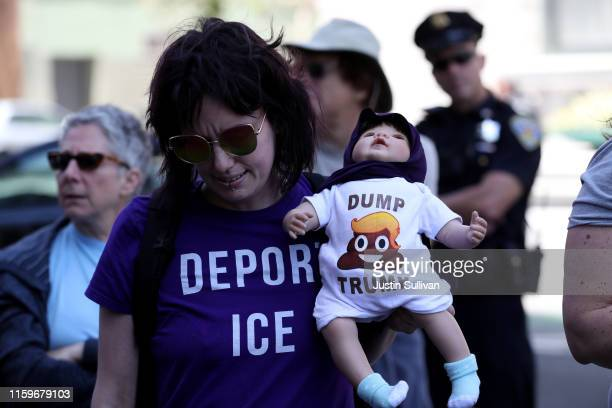 A protester holds a doll with a Dump Trump shirt during a demonstration against migrant detention facilities on July 2 2019 in San Francisco...