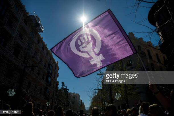 A protester holds a feminist flag during the demonstration International Womens Day is an official holiday for women Women took to the streets...
