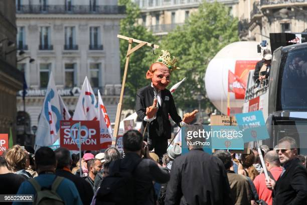 A protester holds a figure mocking the French President during a protest dubbed a quotParty for Macronquot against the policies of the French...