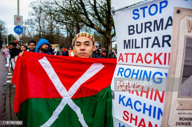 Protester holds a flag during the demonstration. Hundreds of people from The European Rohingya Council and Myanmar Muslim Association Netherlands...